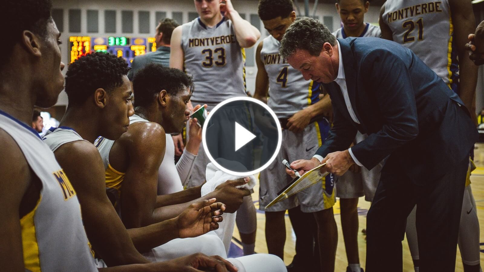 video thumbnail of coach in team huddle